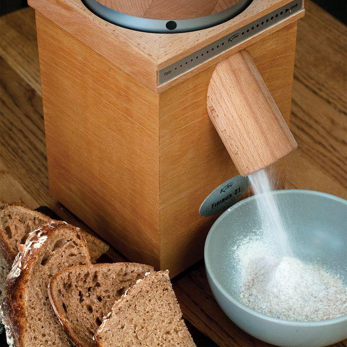 A beechwood countertop grain mill, made by KoMo.