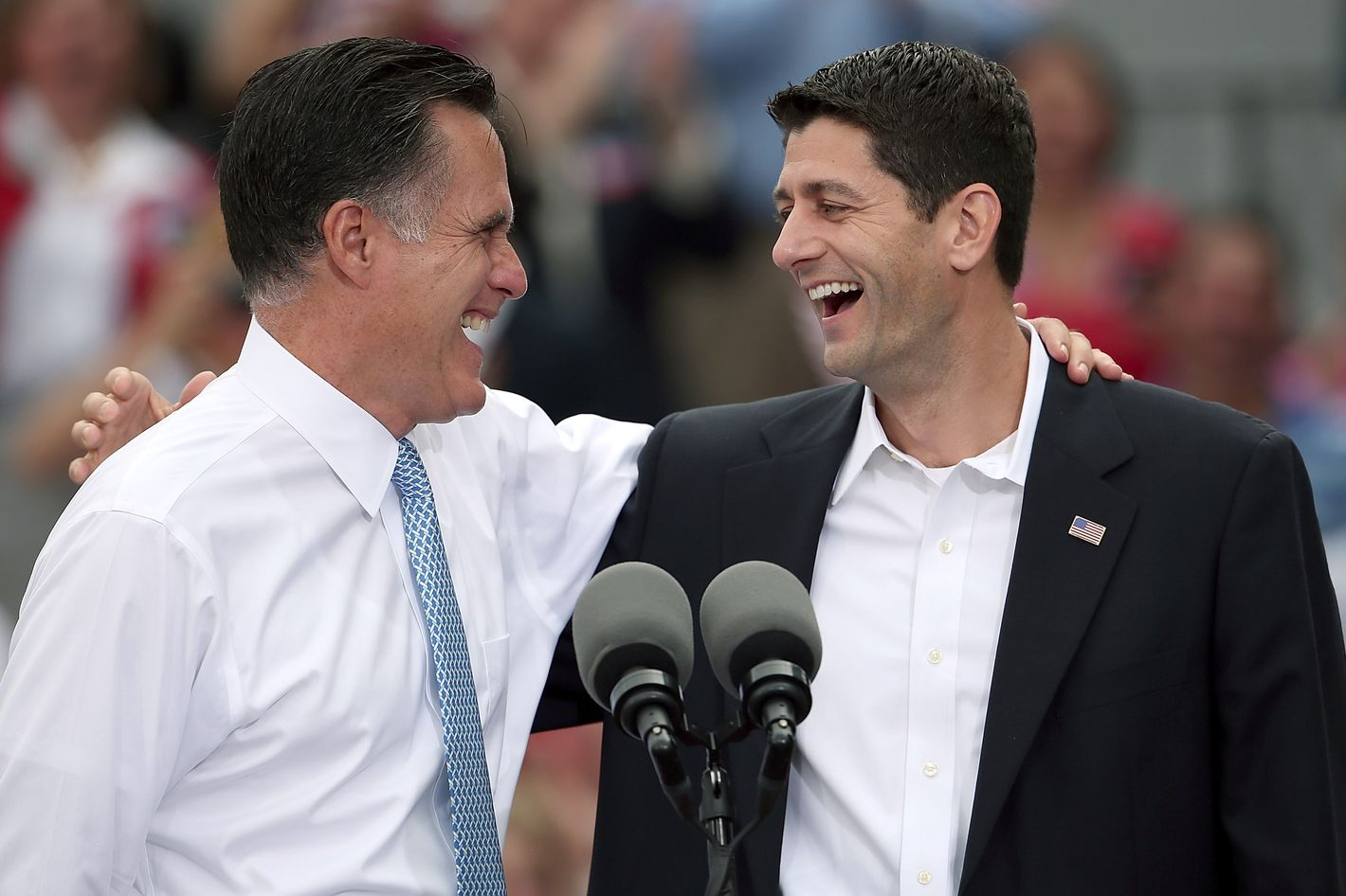 "NORFOLK, VA - AUGUST 11:  Republican presidential candidate, former Massachusetts Gov. Mitt Romney (L) jokes with Rep. Paul Ryan (R-WI) (R) after announcing him as the ""next PRESIDENT of the United States"" during an event announcing him as his running mate in front of the USS Wisconsin August 11, 2012 in Norfolk, Virginia. Ryan, a seven term congressman, is Chairman of the House Budget Committee and provides a strong contrast to the Obama administration on fiscal policy.  (Photo by Win McNamee/Getty Images)"