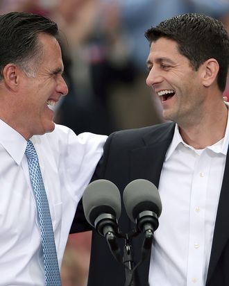 NORFOLK, VA - AUGUST 11: Republican presidential candidate, former Massachusetts Gov. Mitt Romney (L) jokes with Rep. Paul Ryan (R-WI) (R) after announcing him as the
