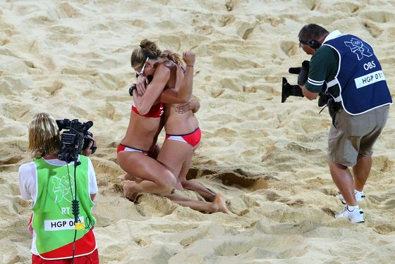 LONDON, ENGLAND - AUGUST 08:  Kerri Walsh Jennings (R) and Misty May-Treanor of the United States celebrates winning the Gold medal in the Women's Beach Volleyball Gold medal match against the United States on Day 12 of the London 2012 Olympic Games at the Horse Guard's Parade on August 8, 2012 in London, England.  (Photo by Ryan Pierse/Getty Images)