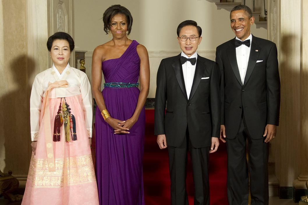US President Barack Obama and First Lady Michelle stand with South Korean President Lee Myung-bak and First Lady Kim Yoon-ok to take the official photo at the White House in Washington, DC, October 13, 2011.     AFP PHOTO/Jim WATSON (Photo credit should read JIM WATSON/AFP/Getty Images)