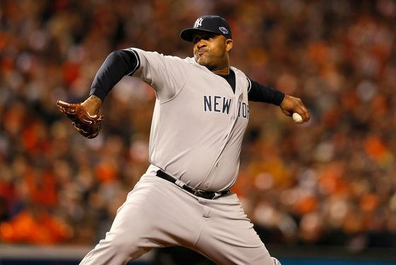 CC Sabathia #52 of the New York Yankees throws a pitch against the Baltimore Orioles during Game One of the American League Division Series at Oriole Park at Camden Yards on October 7, 2012 in Baltimore, Maryland.