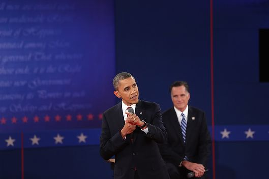 HEMPSTEAD, NY - OCTOBER 16:  Republican presidential candidate Mitt Romney listens as U.S. President Barack Obama (L) answers a question during a town hall style debate at Hofstra University October 16, 2012 in Hempstead, New York. During the second of three presidential debates, the candidates fielded questions from audience members on a wide variety of issues.  (Photo by Spencer Platt/Getty Images)