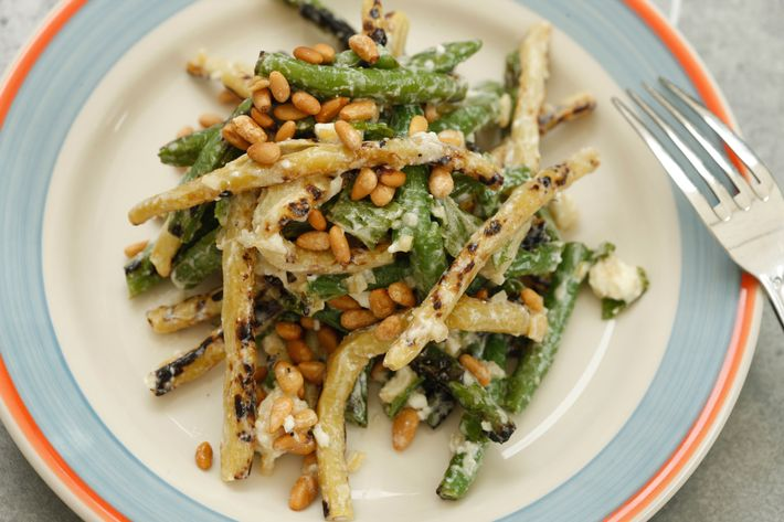 Grilled summer beans with preserved lemon vinaigrette, chiles, feta, and pine nuts.