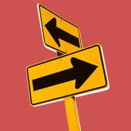 Arrows on road signs pointing in different directions, close-up