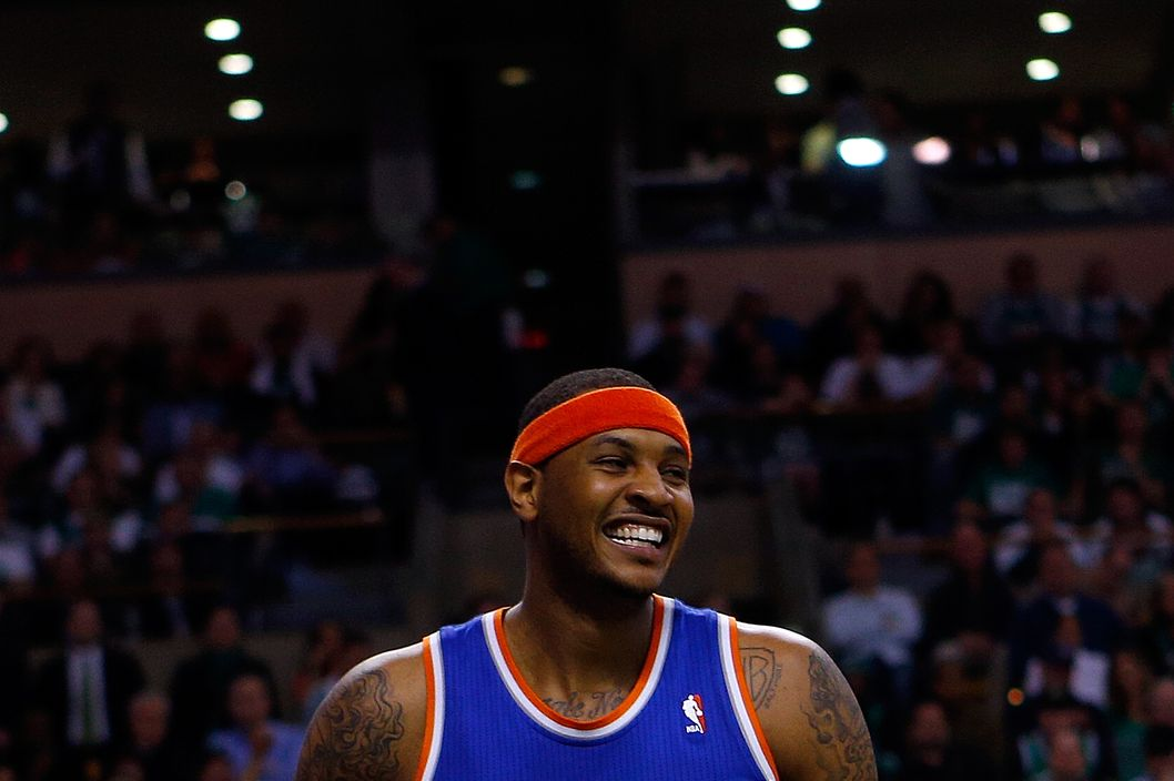 BOSTON, MA - MAY 3: Carmelo Anthony #7 of the New York Knicks react against the Boston Celtics during Game Six of the Eastern Conference Quarterfinals of the 2013 NBA Playoffs on May 3, 2013 at TD Garden in Boston, Massachusetts. NOTE TO USER: User expressly acknowledges and agrees that, by downloading and or using this photograph, User is consenting to the terms and conditions of the Getty Images License Agreement. (Photo by Jim Rogash/Getty Images)