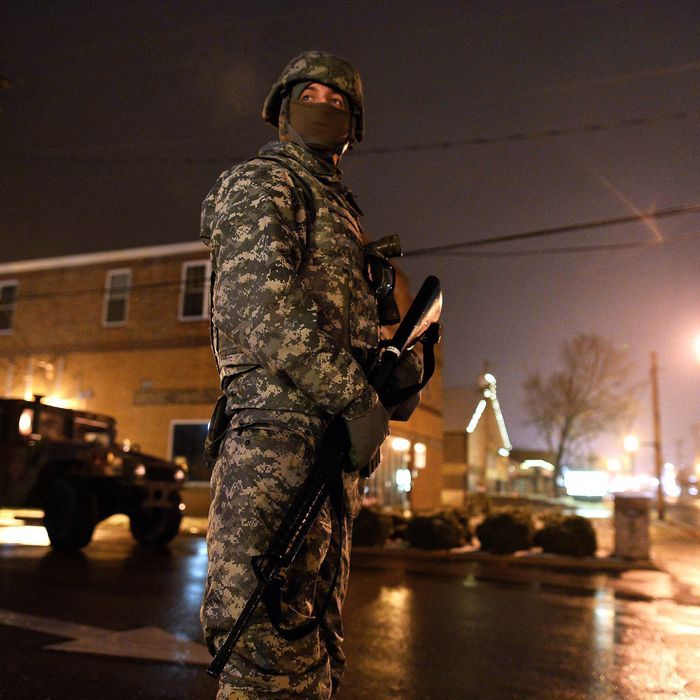 A National Guard trooper keeps vigil on a street near police station in Ferguson, Missouri, on November 26, 2014.