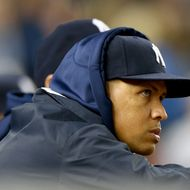 NEW YORK, NY - SEPTEMBER 26: Alex Rodriguez #13 of the New York Yankees looks on from the dugout in the eighth inning against the Tampa Bay Rays on September 26, 2013 at Yankee Stadium in the Bronx borough of New York City. (Photo by Elsa/Getty Images)