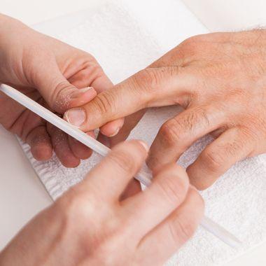 Manicure man close-up to the beauty salon
