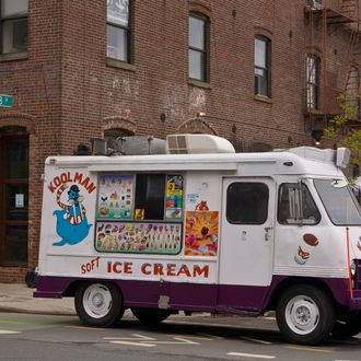 An old fashioned neighborhood ice cream truck is parked in Williamsburg