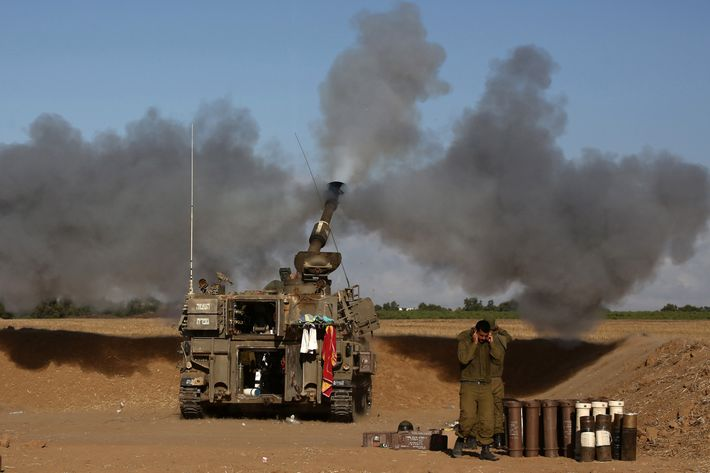 A 155mm artillery, positioned near the Israeli border with the Gaza Strip, fires a projectile towards targets in the Palestinian enclave, on July 17, 2014. Israel and the Islamist Hamas movement have agreed on a ceasefire that will begin at 0300 GMT on Friday, an Israeli official told AFP. AFP PHOTO /MENAHEM KAHANA (Photo credit should read MENAHEM KAHANA/AFP/Getty Images)