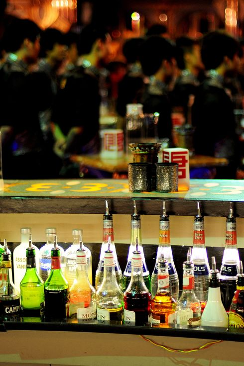 Bottles of drinks are lined up at a club in Hefei, east China's Anhui province on November 8, 2011. As the many million of graduates and white collar job seeks pouring into China big cities in search of thrill and better life, they regulate thrill ridden entertainment venues and are decorating the night scenes of the city's disco clubs. Alcohol, sex, dances, and shows are all part of the funs, especially on the weekend, that night entertainment venues, bars, taverns, social clubs and disco clubs are springing up like mushrooms.    CHINA OUT AFP PHOTO (Photo credit should read STR/AFP/Getty Images)