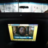 An interactive television system is shown in the back seat of a taxi January 31, 2003 in New York City.