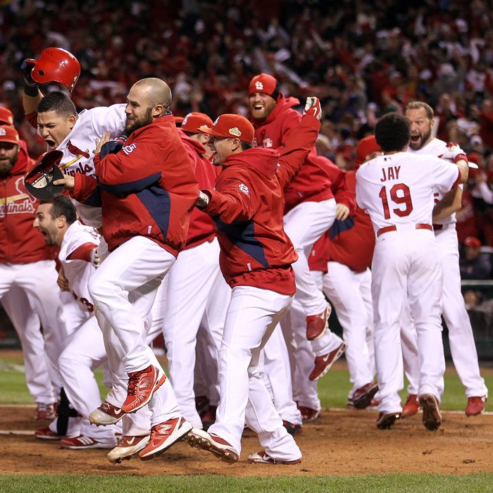 ST LOUIS, MO - OCTOBER 27: Yadier Molina #4 of the St. Louis Cardinals celebrates after David Freese #23 hits a walk off solo home run in the 11th inning to win Game Six of the MLB World Series against the Texas Rangers at Busch Stadium on October 27, 2011 in St Louis, Missouri. The Cardinals won 10-9. (Photo by Ezra Shaw/Getty Images)