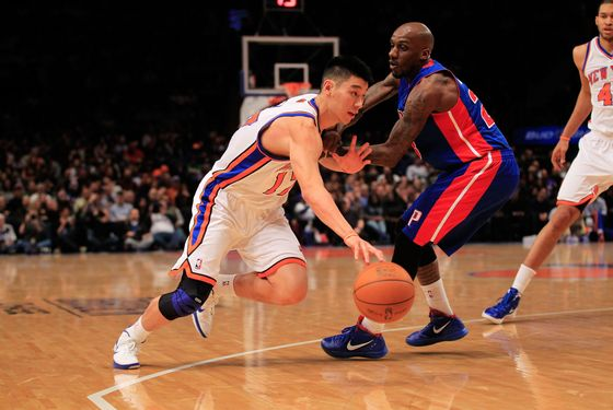 NEW YORK, NY - JANUARY 31:  Jeremy Lin #17 of the New York Knicks drives past Detroit Pistons Walker Russell #23 of the Detroit Pistons at Madison Square Garden on January 31, 2012 in New York City.  NOTE TO USER: User expressly acknowledges and agrees that, by downloading and or using this photograph, User is consenting to the terms and conditions of the Getty Images License Agreement. (Photo by Chris Trotman/Getty Images)