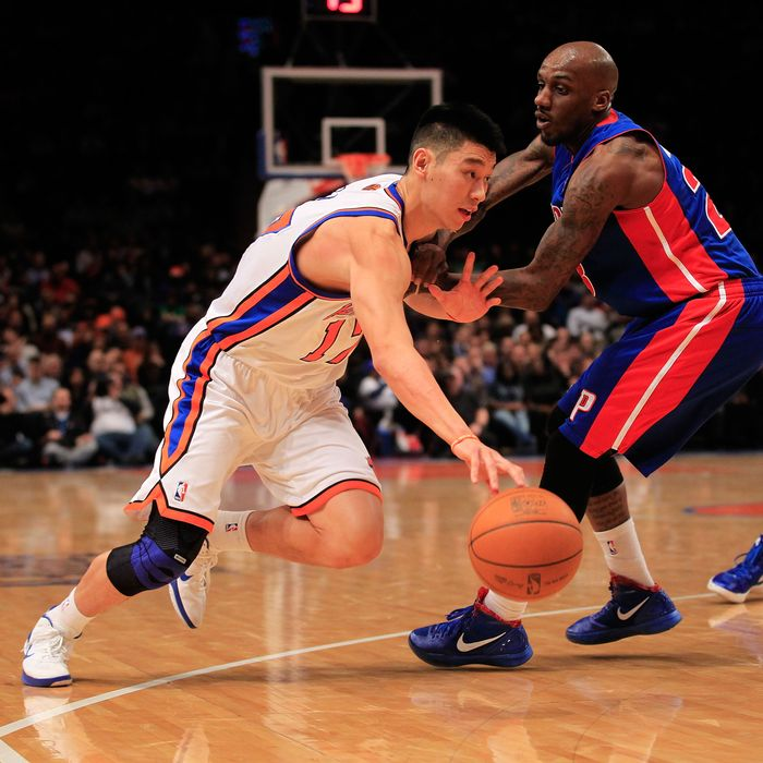 Jeremy Lin #17 of the New York Knicks drives past Detroit Pistons Walker Russell #23 of the Detroit Pistons at Madison Square Garden on January 31, 2012 in New York City.