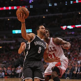 CHICAGO, IL - MAY 02: Deron Williams #8 of the Brooklyn Nets drives past Jimmy Butler #21 of the Chicago Bulls in Game Six of the Eastern Conference Quarterfinals during the 2013 NBA Playoffs at the United Center on May 2, 2013 in Chicago, Illinois. NOTE TO USER: User expressly acknowledges and agrees that, by downloading and or using this photograph, User is consenting to the terms and conditions of the Getty Images License Agreement. (Photo by Jonathan Daniel/Getty Images)