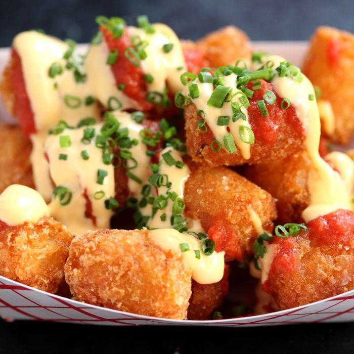 Tabasco Tots are topped with Tabasco mayo, tomato, and pizza spices.