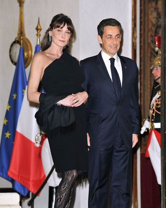 Bruni at a function with her husband, French president Nicolas Sarkozy, on March 2.