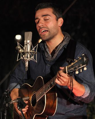 Actor Oscar Issac performs onstage during reception honoring Joel and Ethan Coen and T Bone Burnett to celebrate the music of