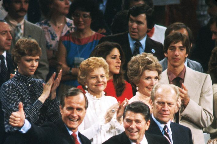 Republican presidential and vice presidential candidates Ronald Reagan and George Bush smile at the Republican National Convention July 21, 1980 in Detroit, MI.