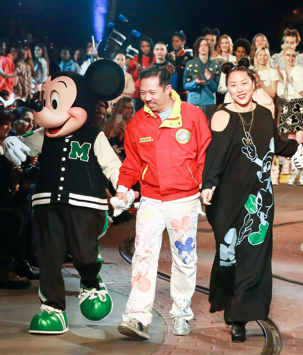 Carol Lin and Humberto Leon with Mickey Mouse at the show.