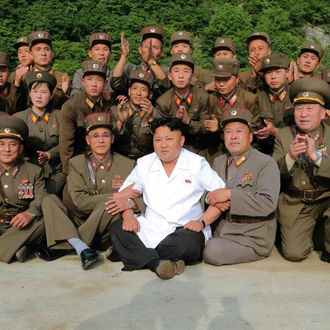 June 30, 2014 - Pyongyang, North Korea: Top leader of the Democratic People's Republic of Korea Kim Jong Un poses for a photo as he oversees a tactical rocket firing drill of the DPRK military. The DPRK has launched precision guided missiles and fired shells with dispersion effect for striking both individual and group targets of the enemy in the drill. (Xinhua/Polaris) ///