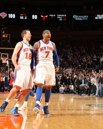 Carmelo Anthony #7 of the New York Knicks, who has hit two last second shots to win in overtime, celebrates victory with Steve Novak #16 of the New York Knicks during the game between the Chicago Bulls and the New York Knicks on April 8, 2012 at Madison Square Garden in New York City, New York.