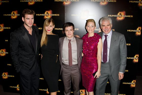 "PARIS, FRANCE - MARCH 15:  (L to R) Liam Hemsworth, Jennifer Lawrence, Josh Hutcherson, Elizabeth Banks and Gary Ross attend the ""Hunger Games"" Paris Premiere photocall at Cinema Gaumont Marignan on March 15, 2012 in Paris, France.  (Photo by Marc Piasecki/WireImage)"
