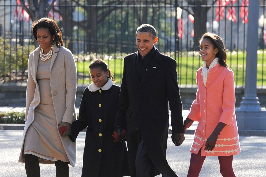 "U.S. President Barack Obama, first lady Michelle Obama (L) and daughters Malia Obama (R) and Sasha Obama (2L) walk from the White House across Lafayette Park to St. John's Church for Sunday services December 11, 2011 in Washington, DC. Obama stance on faith was attacked in a commercial by Rick Perry, claiming he has a ""war on religion""."