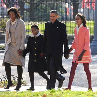 U.S. President Barack Obama, first lady Michelle Obama (L) and daughters Malia Obama (R) and Sasha Obama (2L)