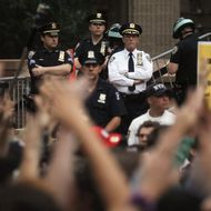 NEW YORK, NY - SEPTEMBER 30:  Demonstrators rally outside One Police Plaza as police look on during a march by protestors affiliated with the Occupy Wall Street movement on September 30, 2011 New York City. Over one thousand activists marched to protest police brutality while clogging traffic in Lower Manhattan. Occupy Wall Street demonstrators are opposed to outsized corporate profits on Wall Street.  (Photo by Mario Tama/Getty Images)
