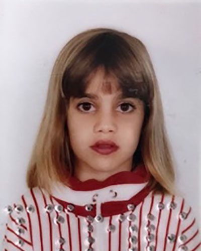 Camila's passport photo at the age of nine.