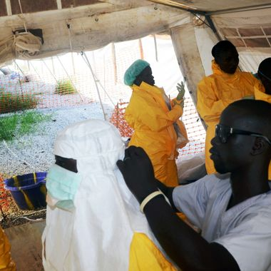 A picture taken on June 28, 2014 shows members of Doctors Without Borders (MSF) putting on protective gear at the isolation ward of the Donka Hospital in Conakry, where people infected with the Ebola virus are being treated. The World Health Organization has warned that Ebola could spread beyond hard-hit Guinea, Liberia and Sierra Leone to neighbouring nations, but insisted that travel bans were not the answer. To date, there have been 635 cases of haemorrhagic fever in Guinea, Liberia and Sierra Leone, most confirmed as Ebola. A total of 399 people have died, 280 of them in Guinea.