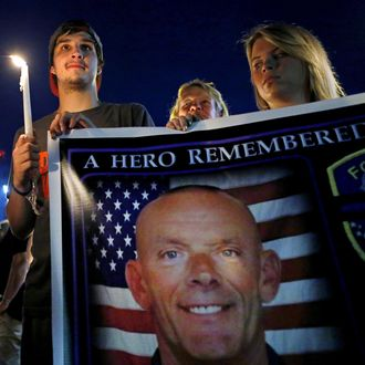 Mourners attend a candlelight vigil for slain Fox Lake Police Lieutenant Charles Joseph Gliniewicz in Fox Lake