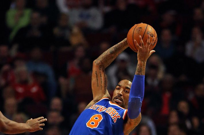 J.R. Smith #8 of the New York Knicks rebounds against the Chicago Bulls at the United Center on April 11, 2013 in Chicago, Illinois.