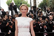 "US actress Uma Thurman poses on the red carpet before the screening of ""Pirates of the Caribbean : On Stranger Tides"" presented out of competition at the 64th Cannes Film Festival on May 14, 2011 in Cannes.   AFP PHOTO / ANNE-CHRISTINE POUJOULAT (Photo credit should read ANNE-CHRISTINE POUJOULAT/AFP/Getty Images)"