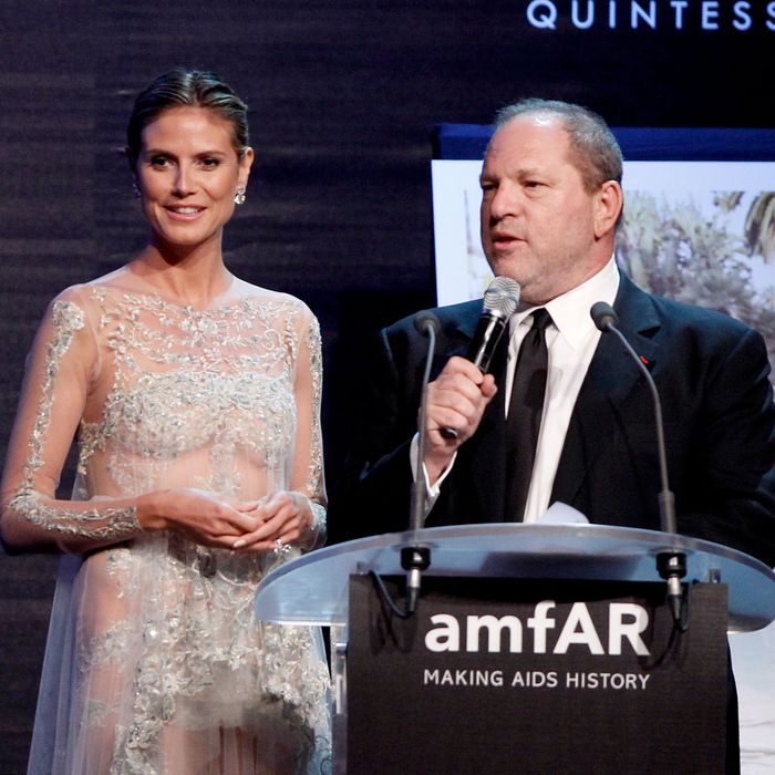 (L-R) Heidi Klum and producer Harvey Weinstein speak onstage during the 2012 amfAR's Cinema Against AIDS during the 65th Annual Cannes Film Festival at Hotel Du Cap on May 24, 2012 in Cap D'Antibes, France.
