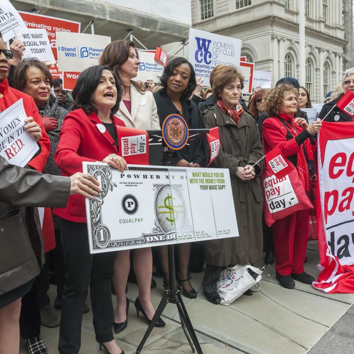 PowHer NY speaks on the steps of City Hall in New York at a rally against pay disparity on Equal Pay Day last month.