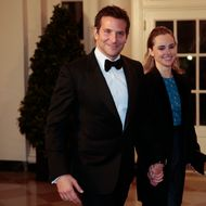 WASHINGTON, DC - FEBRUARY 11: Actor Bradley Cooper, left, and Suki Waterhouse arrive to a state dinner hosted by U.S. President Barack Obama and U.S. first lady Michelle Obama in honor of French President Francois Hollande at the White House on February 11, 2014 in Washington, DC. Obama and Hollande said the U.S. and France are embarking on a new, elevated level of cooperation as they confront global security threats in Syria and Iran, deal with climate change and expand economic cooperation. (Photo by Andrew Harrer-Pool/Getty Images)