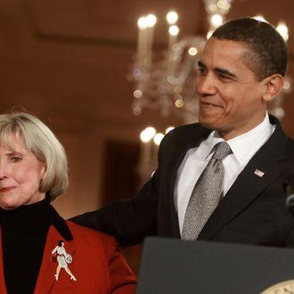 WASHINGTON - JANUARY 29: U.S. President Barack Obama hugs Lilly Ledbetter before signing the
