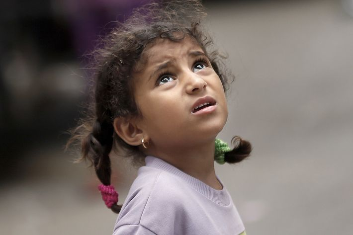 A Palestinian girl looks up as she watches an Israeli drone flying over her home in Gaza City, early on July 15, 2014. Israel's security cabinet accepted an Egyptian ceasefire proposal, a government spokesman said, after a week of the deadliest violence in and around Gaza in years.