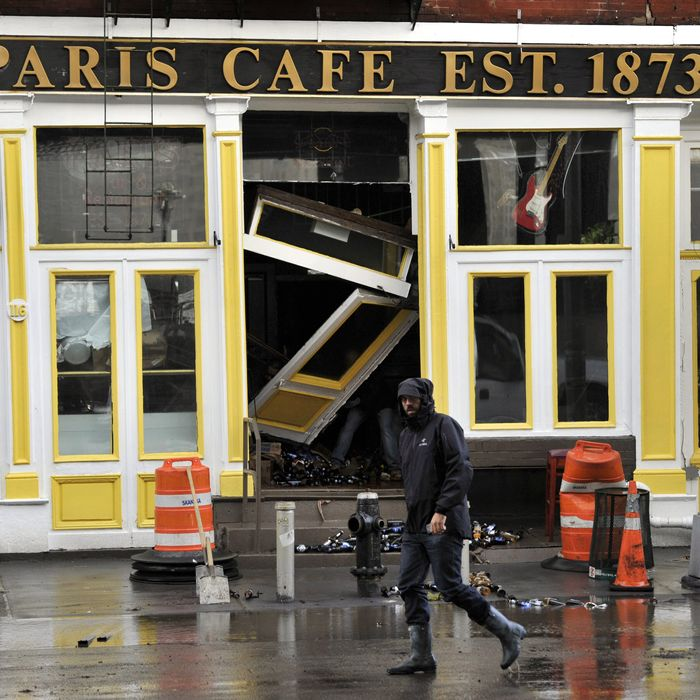 The Paris Cafe, seen here immediately after the storm, reopened on October 17.