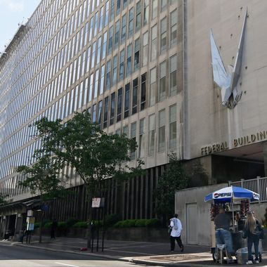 """The John Weld Peck Federal Building, shown Tuesday, May 14, 2013, in Cincinnati, houses the main offices for the Internal Revenue Service in the city. The IRS apologized Friday for what it acknowledged was """"inappropriate"""" targeting of conservative political groups during the 2012 election to see whether they were violating their tax-exempt status. In some cases, the IRS acknowledged, agents inappropriately asked for lists of donors. The agency blamed low-level employees in a Cincinnati office, saying no high-level officials were aware."""