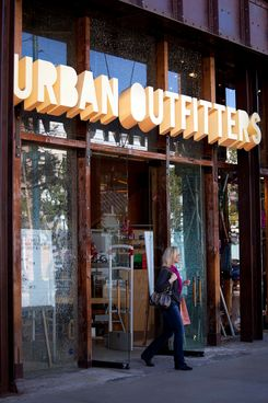 A customer walks out of an Urban Outfitters Inc. store at the Third Street Promenade outdoor mall in Santa Monica, California, U.S, on Monday, Dec. 5, 2011.