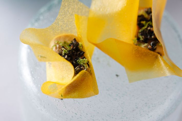Foie gras terrine with mango leather and black sesame.