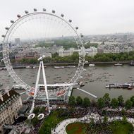 The flotilla of boats passes by the London Eye during the Diamond Jubilee Thames River Pageant on June 3, 2012 in London, England. For only the second time in its history the UK celebrates the Diamond Jubilee of a monarch. Her Majesty Queen Elizabeth II celebrates the 60th anniversary of her ascension to the throne. Thousands of well-wishers from around the world have flocked to London to witness the spectacle of the weekend's celebrations. The Queen along with all members of the royal family will participate in a River Pageant with a flotilla of a 1,000 boats accompanying them down the Thames.