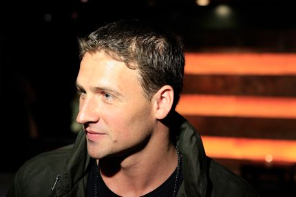 "NEW YORK, NY - SEPTEMBER 06:  Ryan Lochte gives an interview during Ryan Lochte Hosts ""Guys Fashions Night Out"" Presented By Ainsworth Park and Windsor Custom on September 6, 2012 in New York City.  (Photo by Michael Cohen/Getty Images for Fingerprint)"