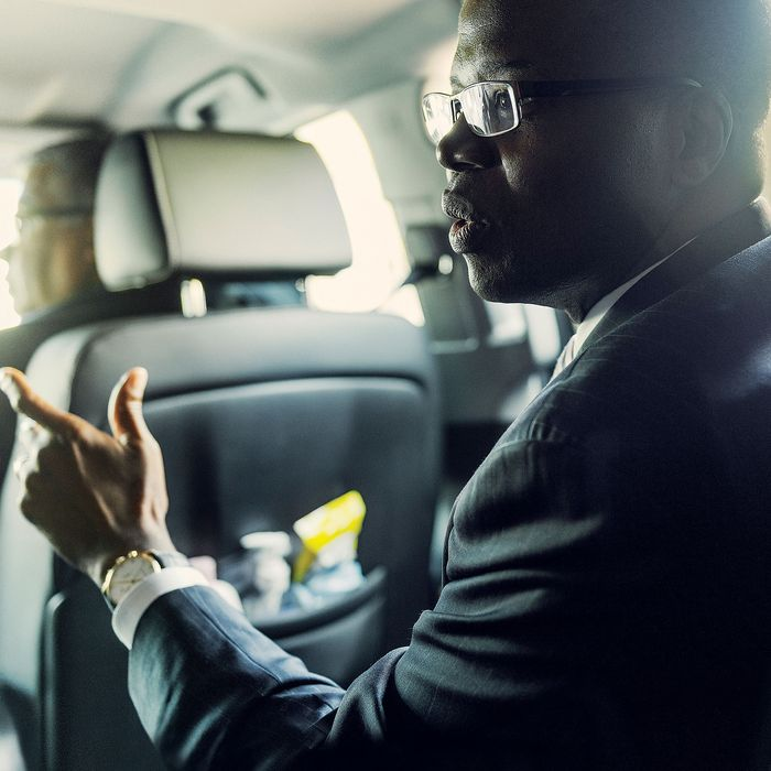 Kings County District Attorney Ken Thompson riding in car and talking with staff