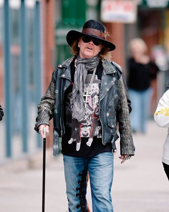16 Apr 2013, Manhattan, New York City, New York State, USA --- Axl Rose seen wearing a studded leather jacket and walking with a cane while taking a stroll in the West Village neighborhood of NYC.